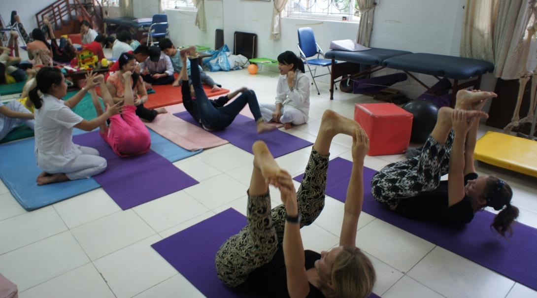 Projects Abroad interns are pictured leading a stretching and exercising class whilst on their physiotherapy internship in Vietnam, Asia.